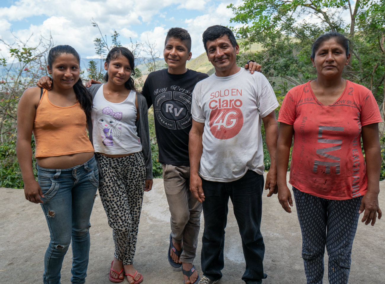 A Peruvian coffee farmer and his family