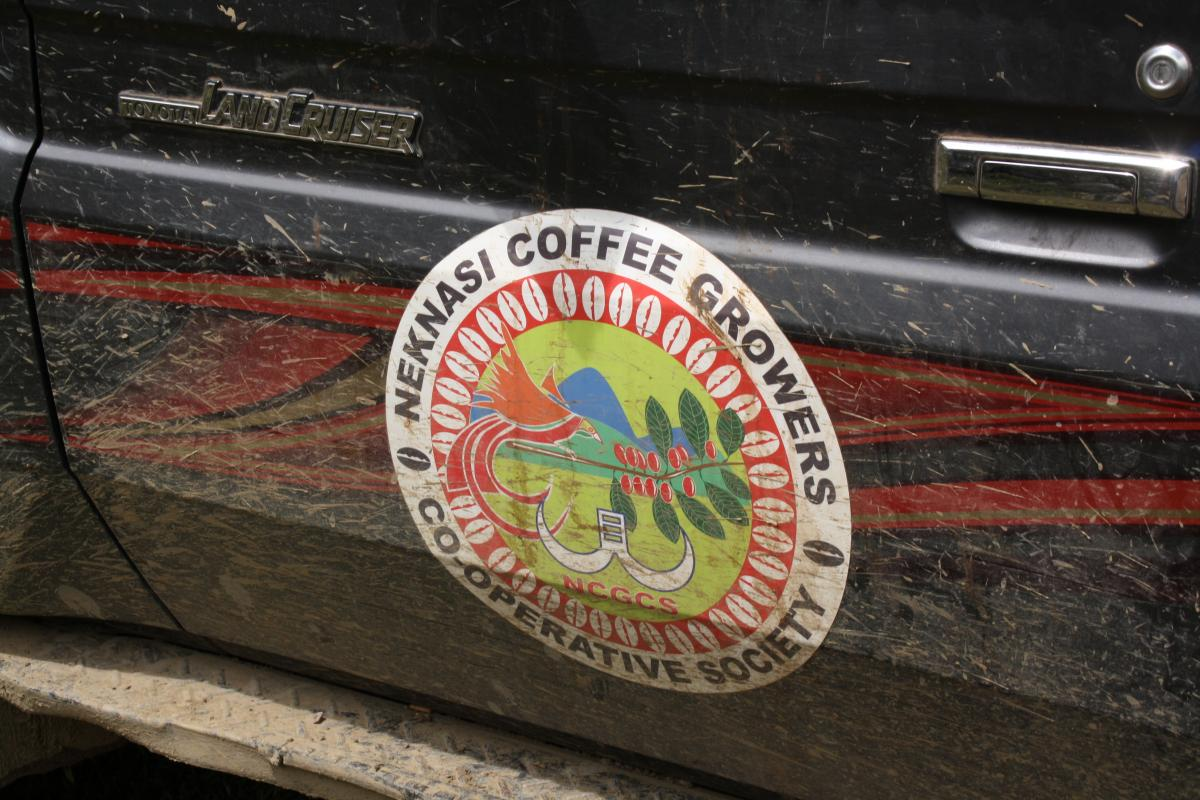 Car with the logo of Neknasi Coffee Growers on the side