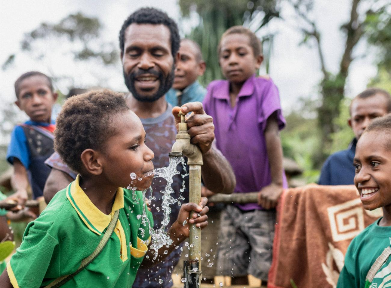 Children drinking water from tap