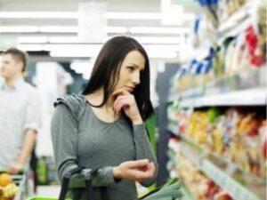Consumer looking at supermarket shelves